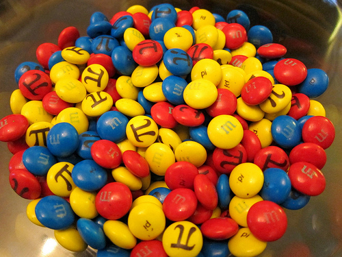 """Image of special M&Ms printed with the """"pi"""" symbol"""